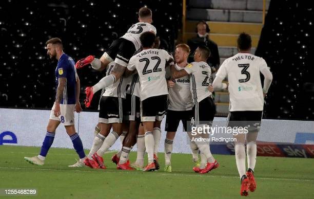 Fulham celebrate their second goal during the Sky Bet Championship match between Fulham and Cardiff City at Craven Cottage on July 10 2020 in London...