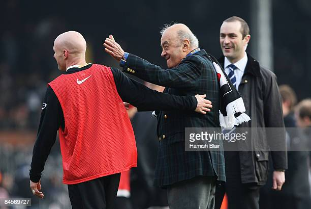 Fulham Chairman Mohamed Al Fayed jokes with Andy Johnson of Fulham ahead of the Barclays Premier League match between Fulham and Portsmouth at Craven...