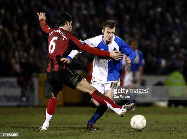 Fulham defender Dejan Stefanovic fouls Chris Lines and is sent off during the FA Cup sponsored by E.ON 3rd Round Replay between Bristol Rovers and...