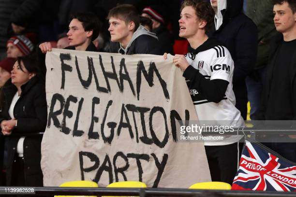 Fulham fans display a banner 'celebrating' their impending relegation during the Premier League match between Watford FC and Fulham FC at Vicarage...