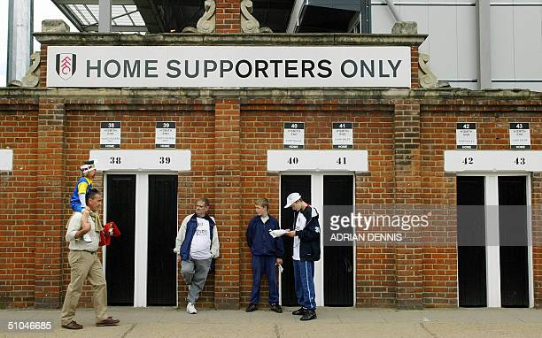 Fulham football club supporters wait outside the turnstiles before the preseason friendly match against Watford at Craven Cottage in London 10 July...