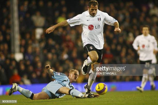 Fulham footballer Shefki Kuqi fends off Nicky Butt of Newcastle during a Premiership match at Craven Cottage in London 15 December 2007 Mobile and...