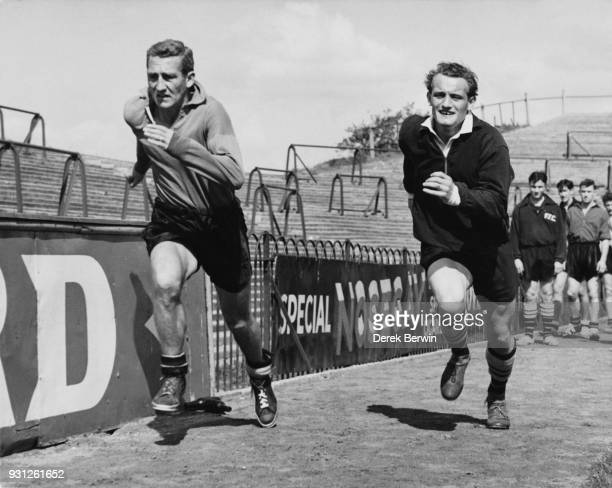 Fulham footballers Roy Bentley and Trevor 'Tosh' Chamberlain during sprint training at Craven Cottage in London 21st August 1957 They are preparing...