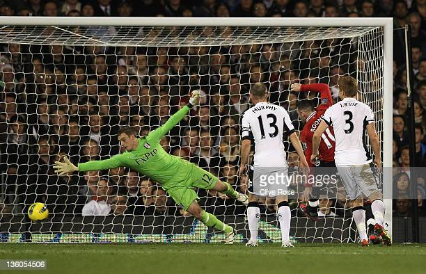 Fulham goalkeeper David Stockdale dives in vain as a header by Nani of Manchester United beats him during the Barclays Premier League match between...