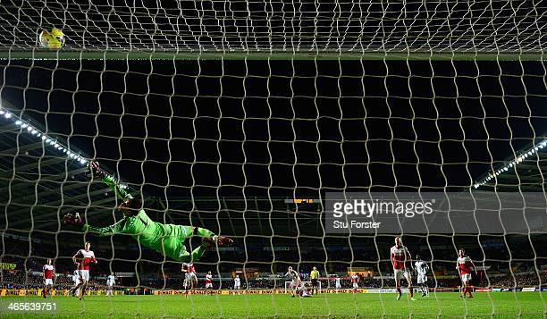 Fulham goalkeeper Maarten Stekelenburg dives in vain as a shot from Jonjo Shelvey of Swansea strikes the bar during the Barclays Premier League match...