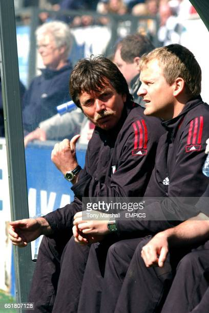 Fulham manager Gaute Haugenes and his assistant Sturla Voll watch the game from the dugout