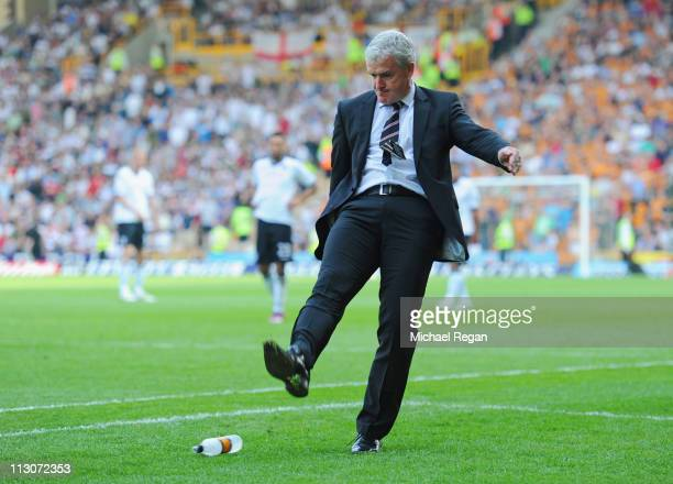 Fulham manager Mark Hughes kicks a bottle in fustraition and is sent to the stands during the Barclays Premier League match between Wolverhampton...