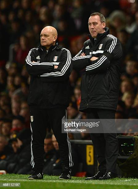 Fulham Manager Rene Meulensteen looks on with Assistant Ray Wilkins during the Barclays Premier League match between Manchester United and Fulham at...