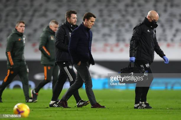 Fulham Manager, Scott Parker walks back to the changing rooms at half time during the Premier League match between Fulham and Manchester United at...