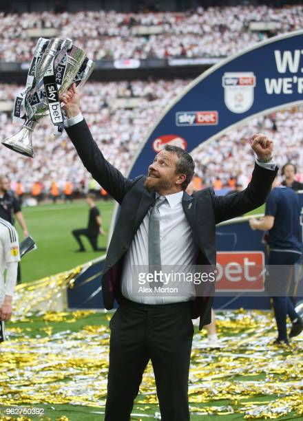 Fulham manager Slavisa Jokanovic celebrates with the Championship Play Off Final trophy during the Sky Bet Championship Play Off Final match between...