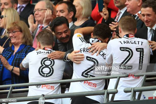 Fulham owner Shahid Khan celebrates with Stefan Johansen Ryan Fredericks and Matt Targett during the Sky Bet Championship Play Off Final between...