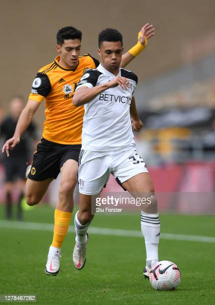 Fulham player Antonee Robinson holds off the challenge of Raul Jimenez during the Premier League match between Wolverhampton Wanderers and Fulham at...