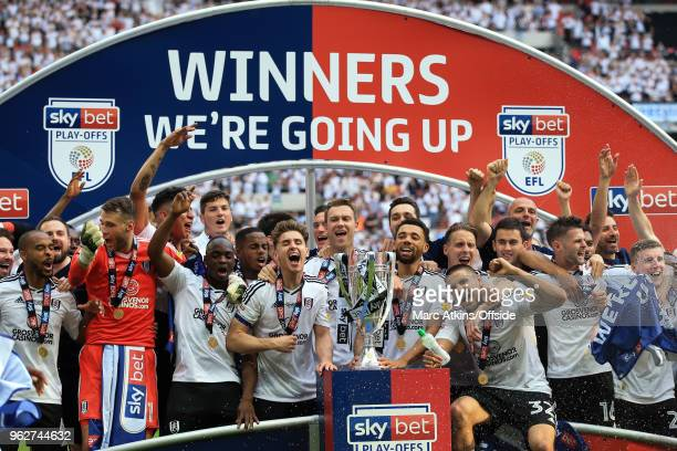 Fulham players celebrate promotion during the Sky Bet Championship Play Off Final between Aston Villa and Fulham at Wembley Stadium on May 26 2018 in...