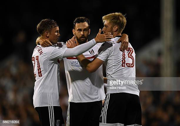 Fulham players celebrate their teams victory following the Sky Bet Championship match between Fulham and Newcastle United at Craven Cottage on August...