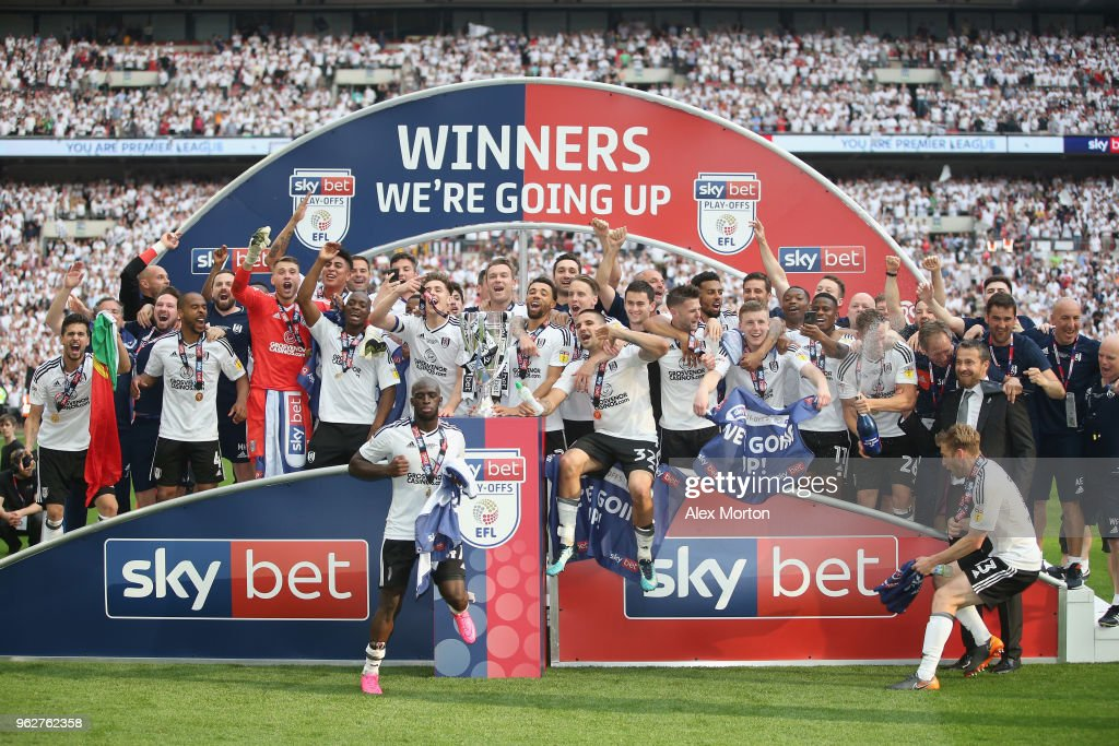Fulham players celebrate with the trophy following their sides victory in the Sky Bet Championship Play Off Final match between Aston Villa and Fulham at Wembley Stadium on May 26, 2018 in London, England.