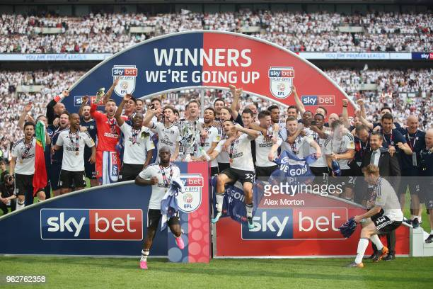 Fulham players celebrate with the trophy following their sides victory in the Sky Bet Championship Play Off Final match between Aston Villa and...
