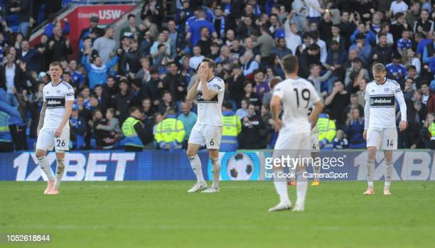 Fulham players look dejected after Cardiff City went 42 up during the Premier League match between Cardiff City and Fulham FC at Cardiff City Stadium...