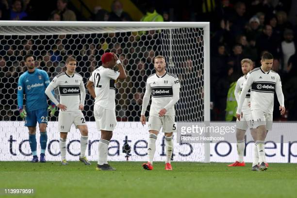 Fulham players look dejected after conceding a second goal during the Premier League match between Watford FC and Fulham FC at Vicarage Road on April...