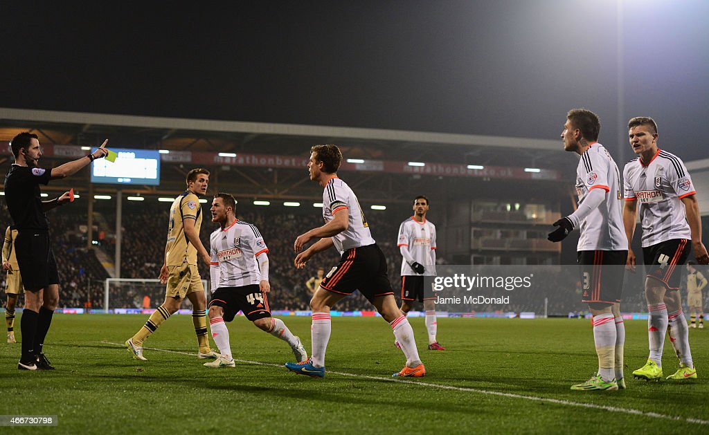 Fulham players protest as Kostas Stafylidis of Fulham (3) is sent off by referee Chris Kavanagh during the Sky Bet Championship match between Fulham and Leeds United at Craven Cottage on March 18, 2015 in London, England.