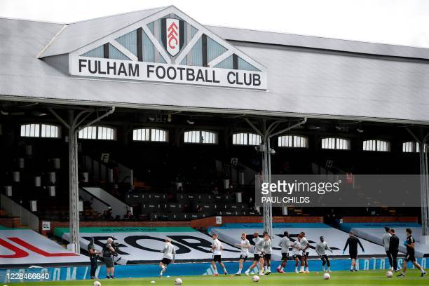 Fulham players warm up ahead of the English Premier League football match between Fulham and Arsenal at Craven Cottage in London on September 12,...