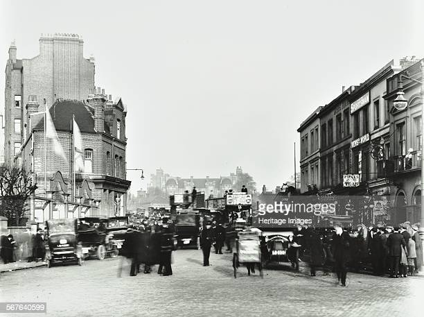 Fulham Road by Stamford Bridge Stadium Fulham London 1912 People cars and buses are crowded outside the entrance to the ground