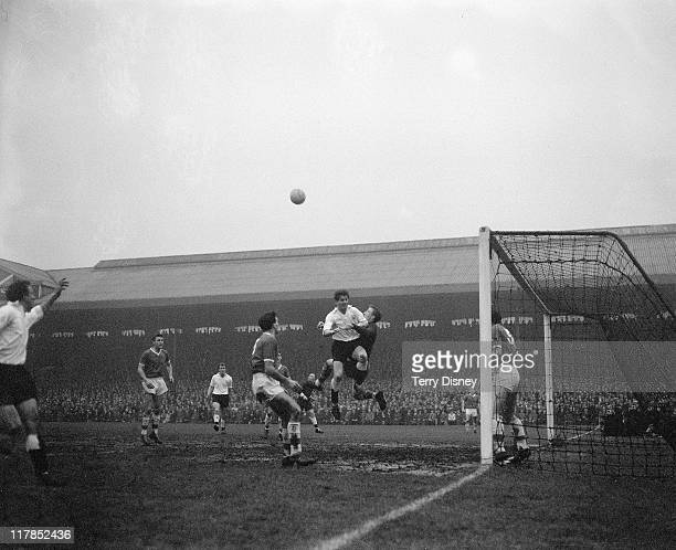 Fulham V Walsall, FA Cup 4th round. Watched by Walsall centre-half McPherson, Walsall goalie Boswell clashes in mid-air with O'Connell, the Fulham...