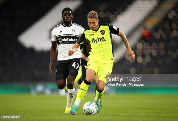 Fulham's Aboubakar Kamara and Exeter City's Lee Martin battle for the ball during the Carabao Cup second round match at Craven Cottage London