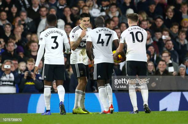 Fulham's Aboubakar Kamara and Fulham's Aleksandar Mitrovic disagree over who will take the penalty during the Premier League match at Craven Cottage...