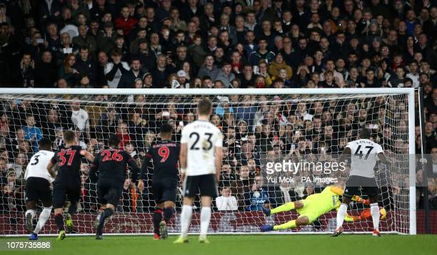 Fulham's Aboubakar Kamara has a penalty saved by Huddersfield Town goalkeeper Jonas Lossl during the Premier League match at Craven Cottage London
