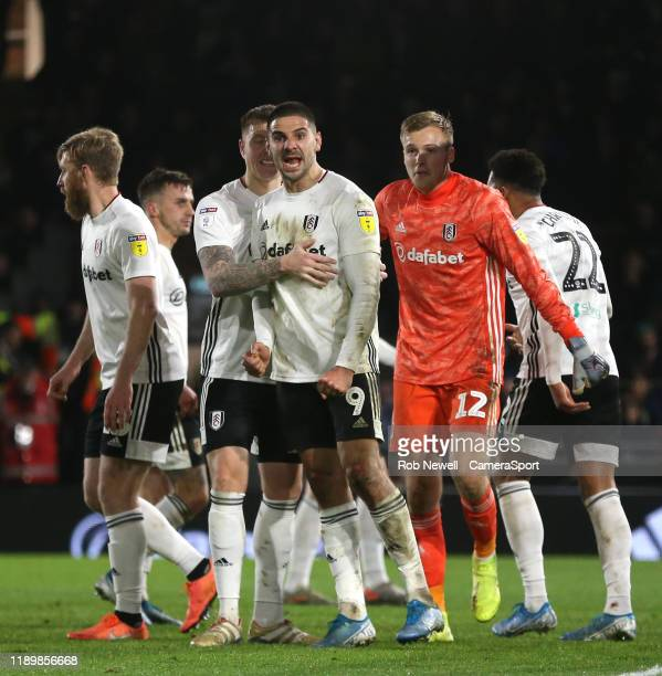 Fulham's Aleksandar Mitrovic celebrates after making a clearance to deny Leeds United's Edward Nketiah during the Sky Bet Championship match between...