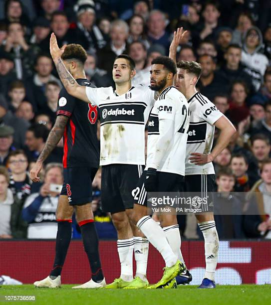 Fulham's Aleksandar Mitrovic gestures to the bench after Fulham's Aboubakar Kamara steps up to take the penalty during the Premier League match at...