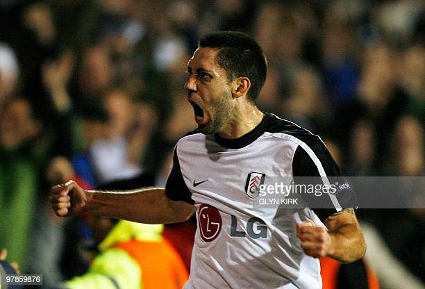 Fulham's American midfielder Clint Dempsey celebrates scoring a goal during their UEFA Europa League round of 16 second leg football match against...