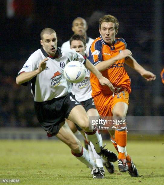 Fulham's Andy Melville and Wycombe's Darren Currie during their AXA FA Cup Third Round replay match at Craven Cottage THIS PICTURE CAN ONLY BE USED...
