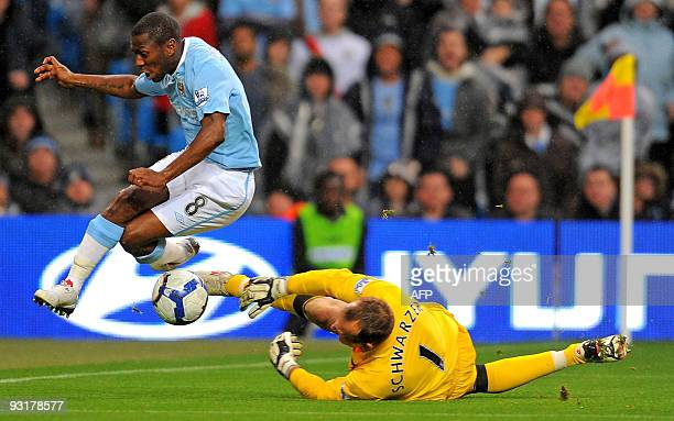 Fulham's Australian goalkeeper Mark Schwarzer saves from Manchester City's English midfielder Shaun WrightPhillips during the English Premier League...