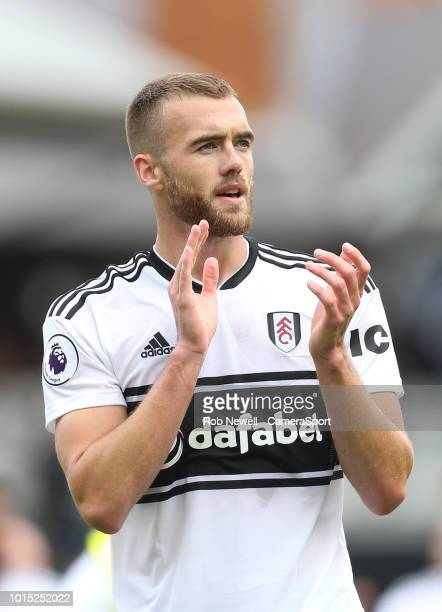 Fulham's Calum Chambers applauds the Fulham fans during the Premier League match between Fulham FC and Crystal Palace at Craven Cottage on August 11...