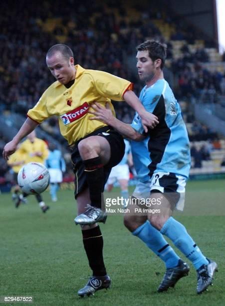 Fulham's Carlos Bocanegra tussles with Watford's Paul Devlin