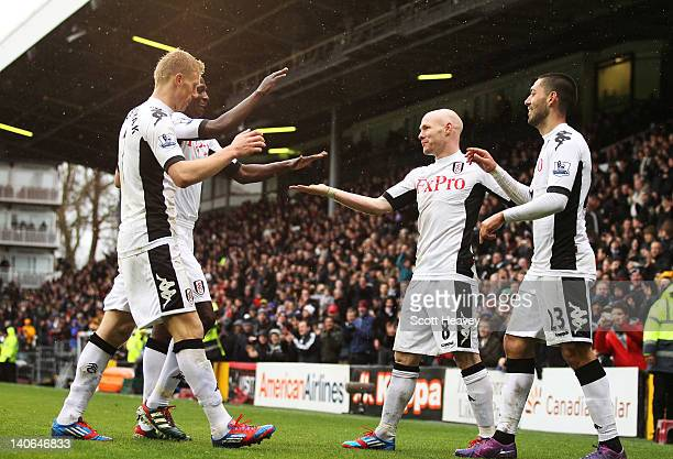 Fulham's Clint Dempsey celebrates with teammates Pavel Pogrebnyak Mahamadou Diarra and Andrew Johnson after scoring his second goal and Fulham's...