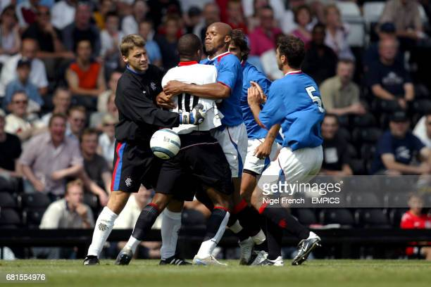 Fulham's Collins John has to be restrained by Rangers' players Sefan Klos and Jean Alain Boumsong