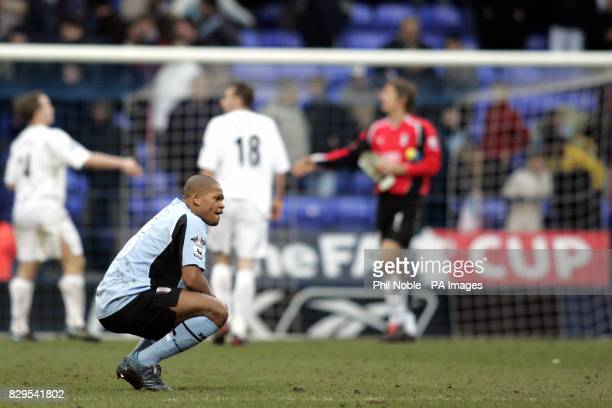 Fulham's Collins John squats down in dejection after losing against Bolton Wanderers