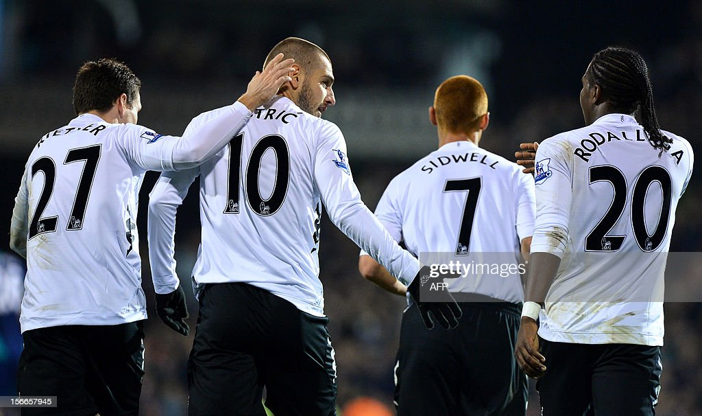 "Fulham's Croatian forward Mladen Petric (2L) celebrates with teammates including Fulham's Colombian striker Hugo Rodallega (R) after scoring a goal during the English Premier League football match between Fulham and Sunderland at Craven Cottage in London on November 18, 2012. USE. No use with unauthorized audio, video, data, fixture lists, club/league logos or ""live"" services. Online in-match use limited to 45 images, no video emulation. No use in betting, games or single club/league/player publications."