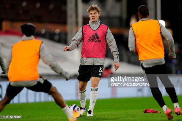Fulham's Danish defender Joachim Andersen warms up ahead of the English Premier League football match between Fulham and Tottenham Hotspur at Craven...