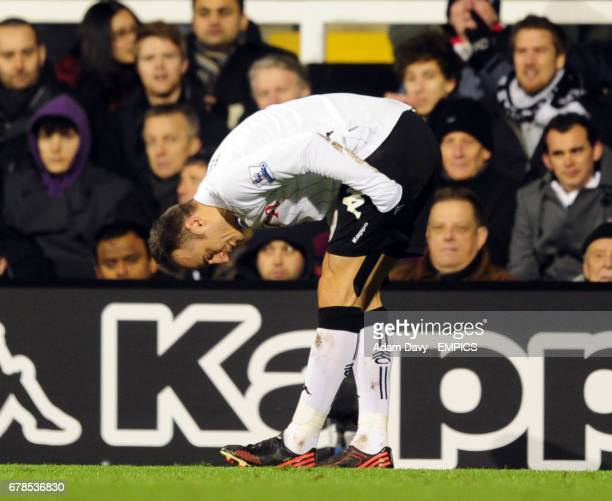 Fulham's Dimitar Berbatov pulls up with a hamstring injury