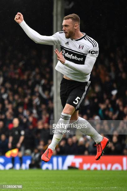 Fulham's English defender Calum Chambers celebrates after scoring their first goal during the English Premier League football match between Fulham...