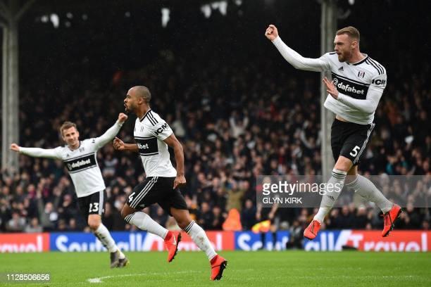 Fulham's English defender Calum Chambers celebrates with Fulham's English defender Joe Bryan and Fulham's Belgian defender Denis Odoi after scoring...