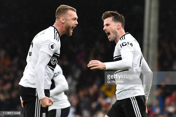 Fulham's English defender Calum Chambers celebrates with Fulham's Norwegian midfielder Havard Nordtveit after scoring their first goal during the...