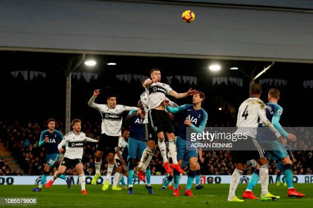 Fulham's English defender Calum Chambers jumps to win a header during the English Premier League football match between Fulham and Tottenham Hotspur...