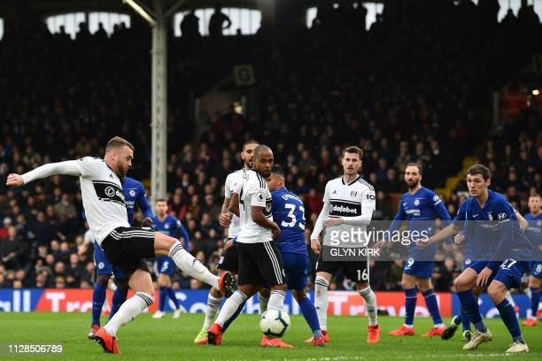 Fulham's English defender Calum Chambers shoots to score their first goal during the English Premier League football match between Fulham and Chelsea...
