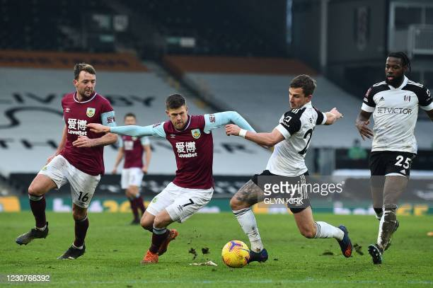 Fulham's English defender Joe Bryan vies for the ball against Burnley's Icelandic midfielder Johann Berg Gudmundsson during the English FA Cup fourth...