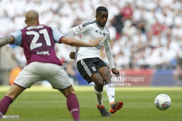 Fulham's English defender Ryan Sessegnon makes a through pass in the build up to the opening goal by Fulham's English midfielder Tom Cairney during...