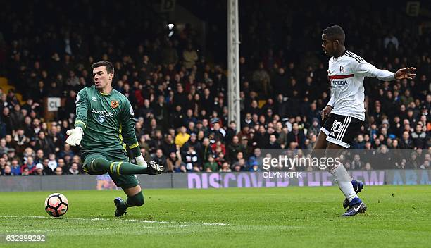 Fulham's English defender Ryan Sessegnon scores their third goal during the English FA Cup fourth round football match between Fulham and Hull City...